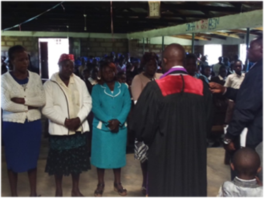 Confirmation of new members during Sunday service at Kithungari church